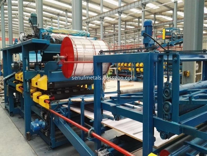 Cladding steel sheets EPS and rockwool sandwich panel forming machine (3)