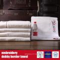 100% serviette de Terry de frontière de Dobby de broderie de coton pour l'hôtel