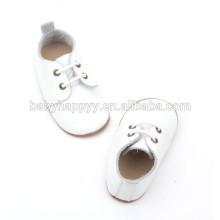Zapatos de bebé blancos llanos vendedores calientes del bautismo del cuero genuino