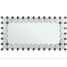 Rectangular bathroom mirror hanging on the wall