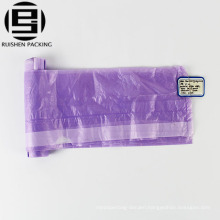 Plastic drawstring garbage packing bag on roll
