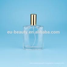 perfume bottle with flower cap in triangular shape