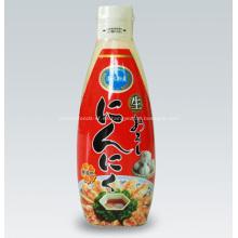 Habitación botella condimento puré de pasta con sabor a ajo