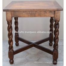 Table à manger en bois massif en mangue aux jambes sculptées