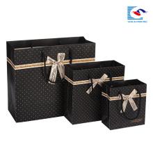 Handmade black spot santa pattern paper bag with bow tie