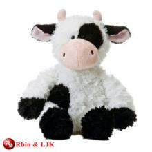 white and black cow plush toy