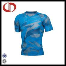 Homens novos da impressão do projeto de forma aptidão dos esportes e camisas do Gym