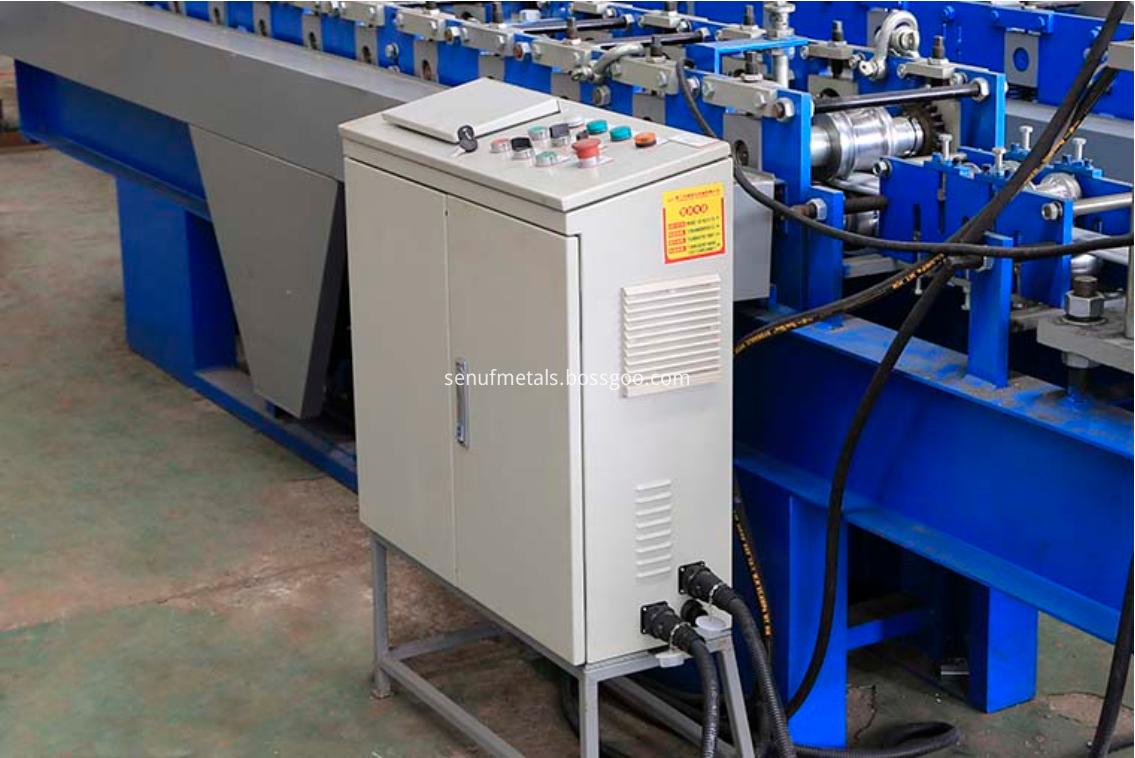 Roller shutter door forming machine PLC control system