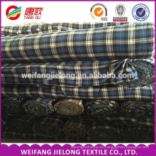 hecho en tela de franela a granel barata de la porción de China stock por tela de franela teñida hilado de algodón de shirt100%