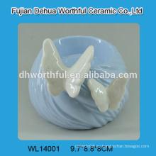 Candelabro de cerámica Elegent con mariposa blanca