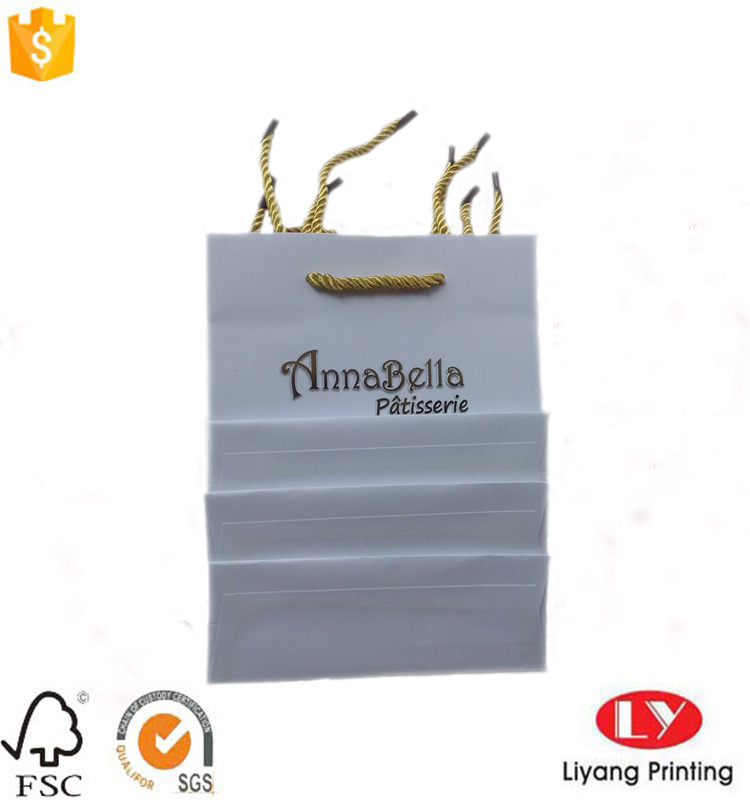 paper bag with gold handle