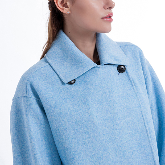The collar of a blue cashmere overcoat