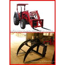 Setzen Sie die Palettengabel auf den Lader für Ihren Traktor