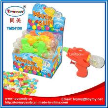 Kleines Wasserpistole-Spielzeug mit Süßigkeit