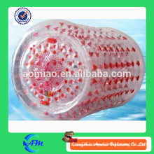 Transparent inflatable water roller with red dots, water filled lawn roller for fun