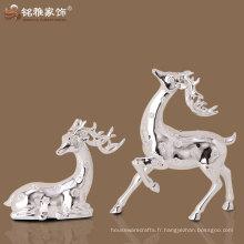 sculptures décoratives et véritables sculptures en cerf argenté avec du matériel en résine pour décoration de table de maison