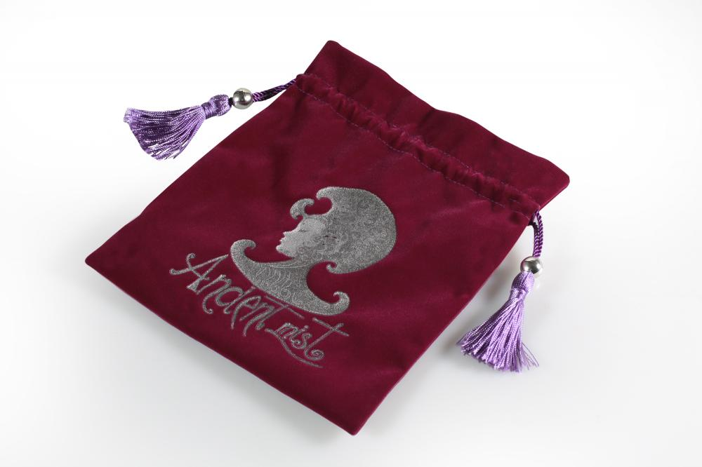 velvet pouch with purple tassel