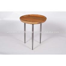 Mesa redonda con patas de hierro