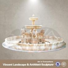 открытый мраморный фонтан с женской статуей
