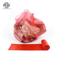 Disposable red drawstring bin liners trash bags