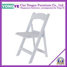 Cadeira de dobradura da categoria comercial da resina branca com assento acolchoado