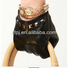 lady wearing short Rivet style leather glove
