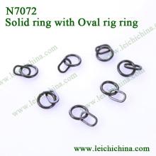 Кольцо с круглым кольцом с овальным кольцом