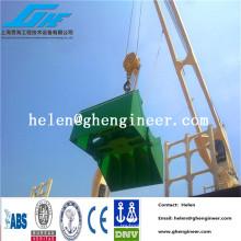 Grappin électro-hydrolique pour minerai de fer