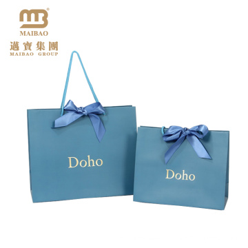 La Chine fabrique en gros de luxe imprimée feuille d'or Logo Design mariage personnalisé papier cadeau sac avec poignée