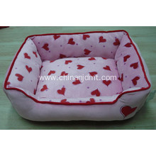 Pink calico dog bed