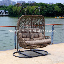Cozy double garden rattan swing chair for 2 people