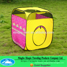 Kid playing pop up tent