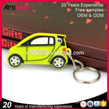 El anillo promocional al por mayor del pvc de la forma del taxi de los productos promocionales del metal mini