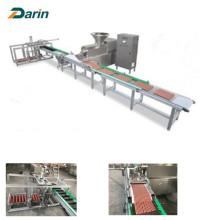Automatic meat bar entry cold extrusion machine
