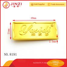 Logos ou étiquettes en métal personnalisés à la mode pour sacs avec une belle apparence et une qualité