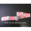 Stationery horizontal flow wrap machine