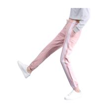 Calças esportivas femininas elegantes de algodão com listras laterais
