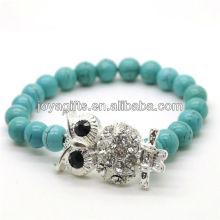 Bracelet en pierres précieuses en pierres rondes et perles rondes turquoise 8 mm avec morceau de hibou en alliage diamant