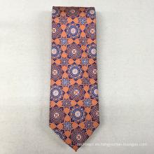 Venda al por mayor los hombres florales anaranjados del traje a medida la tela de seda del 100% para el lazo