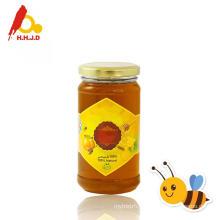 Raw polyflower honey on skin