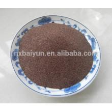 La superficie metálica chorro de arena con abrasivo granate