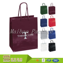 Wholesale Custom Small Quantity Glossy Luxury Merchandise Paper Bags For Clothing Shopping Packaging