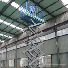 18m 300Kg tipo remolcable industrial elevador de tijera eléctrico