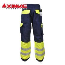 Xinke EN11611 incombustible al por mayor de seguridad utiliza trabajo carga 6 seis pantalones de bolsillo