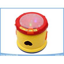 Juguetes musicales educativos del tambor con los juguetes de los bloques