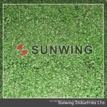 La alfombra de alfombra al aire libre de hierba artificial que se enclavija