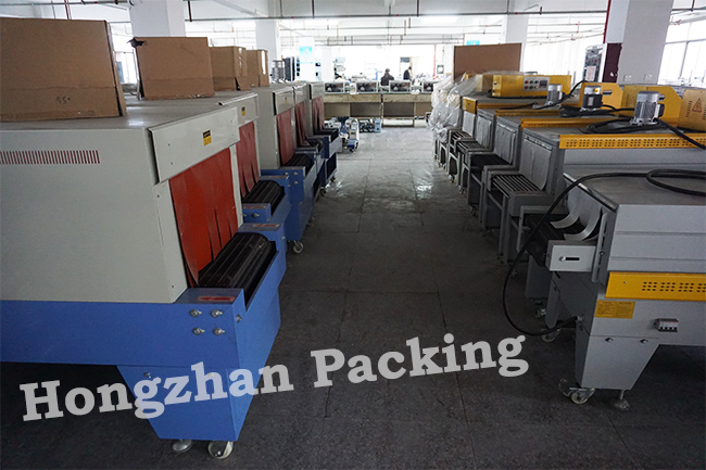 Fast Heat Shrinking Wrapping Machine with Roller Link Plate Stainless Steel Heating Pipe for Small Carton Box Film Wrap Tightly Packing