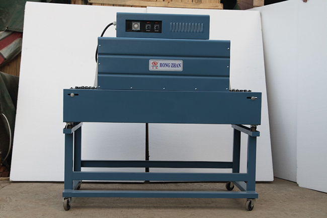 Big Shrinking Oven Packing Machine for Heavy Large Product with Flat Panel Conveyor and Cooling Efrigeration Fan System