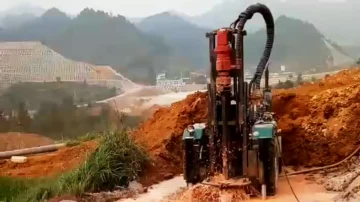 Tractor type water well drilling rig at soil layer worksite.mp4