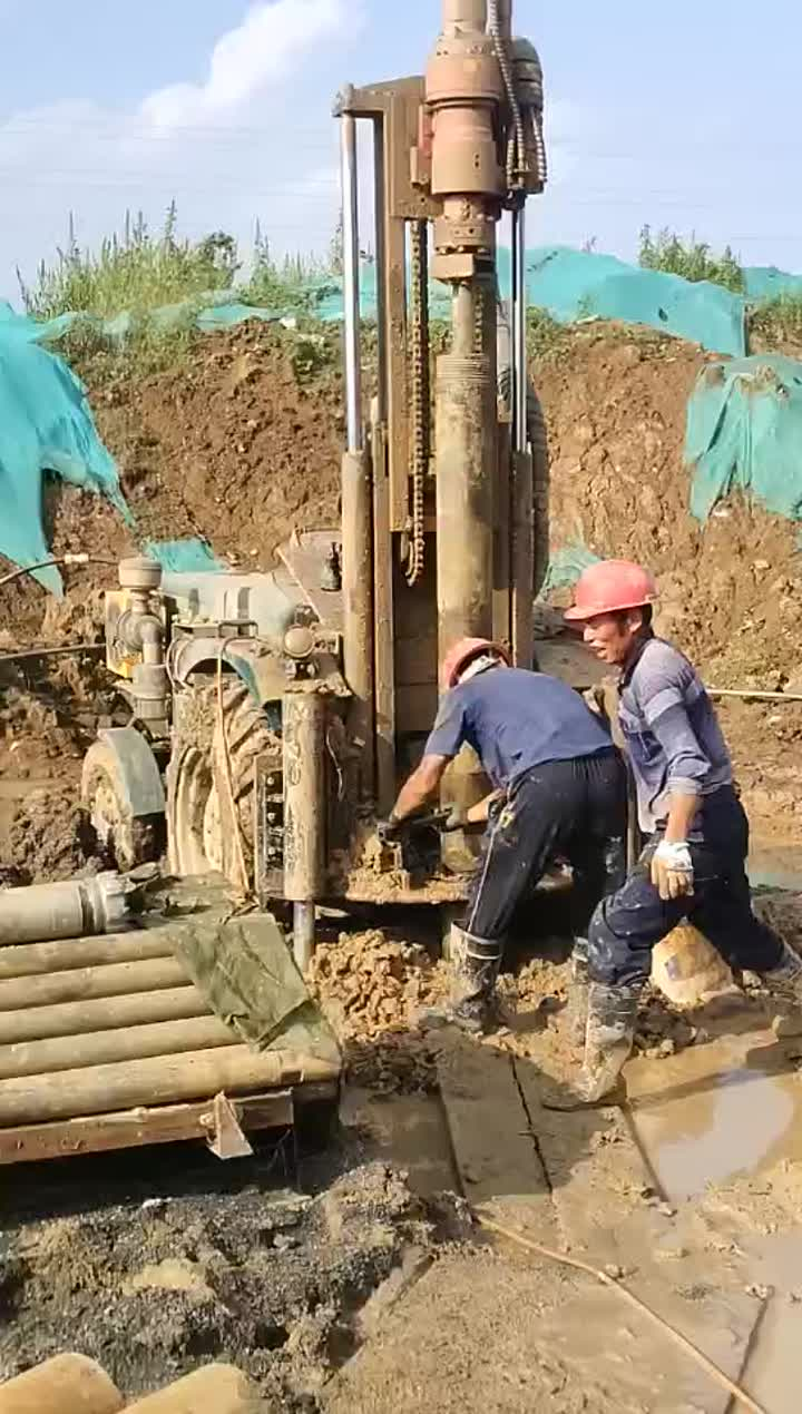 200s tractor water well drilling rig at worksite.mp4